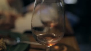 a Glass of White Wine in a Bar