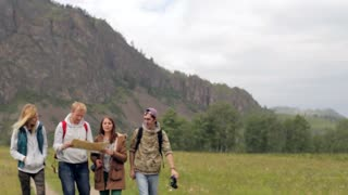 A group of friends is traveling among the mountains