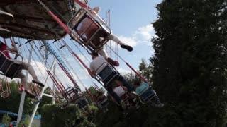 Amusement Park, People Ride the Carousel