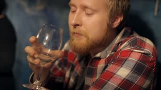 Bearded Man at a Wine Tasting in a Restaurant
