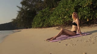beautiful girl sunbathing on the beach