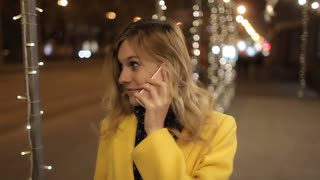 Beautiful Girl Talking on the Phone on the Night City, Illumination
