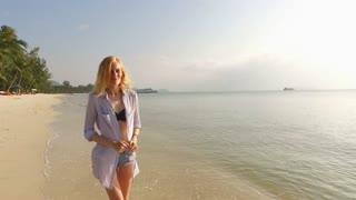 beautiful girl walking on a tropical beach