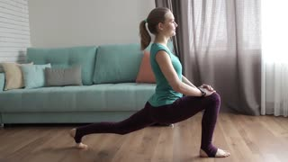 Beautiful Sports Girl Engaged in Home Fitness, Stretching