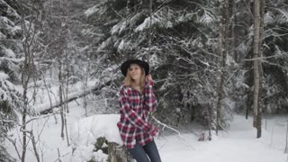 Beautiful Stylish Girl in Hat and Shirt in Winter Forest