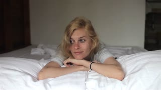 beautiful woman awake lying on the bed