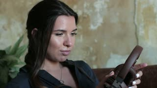 beautiful woman listening to music in wireless headphones