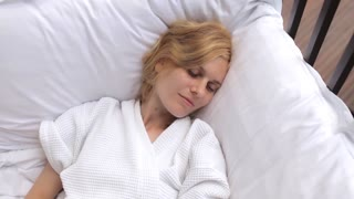 beautiful woman sleeping in bed in the fresh air