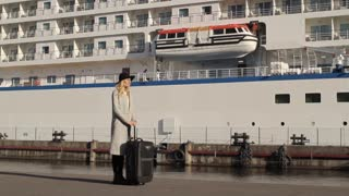 Beautiful Woman With a Suitcase at Sea Cruise Liner