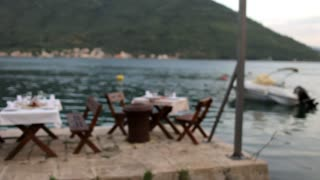blurred restaurant by the lake at dusk