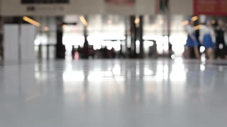 Blurred View of People in the Business Center Lobby