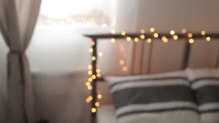 Breakfast in Bed. Blurred Bed With a Garland and Tea
