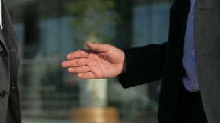 business partner refuses to shake hands, accept an offer