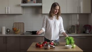 Business Woman Preparing Dinner in the Kitchen, Prepares a Vegetarian Salad. Tearing Salad