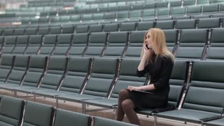 Business Woman Talking on the Phone in an Empty Conference Room