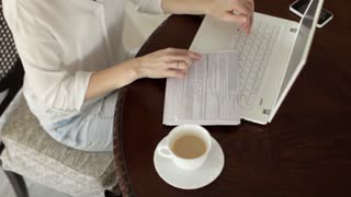 Business Woman Working Behind Laptop at Home