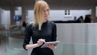 Business Woman Working With Tablet in Lobby Business Center