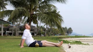 businessman is relaxing on the beach
