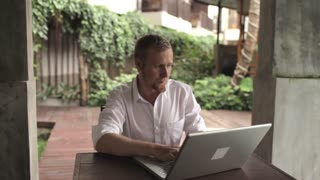 businessman working with laptop in the garden