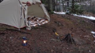 camping by the lake, tent and kerosene lamp