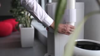 close-up. businessman pouring water from a cooler in the office