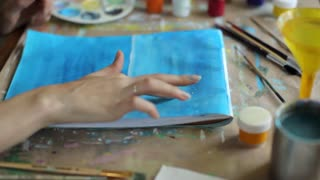 close-up, girl draws a finger picture