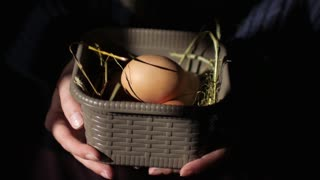 close-up, girl holding a basket with chicken eggs