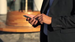 close-up, the businessman is using the phone