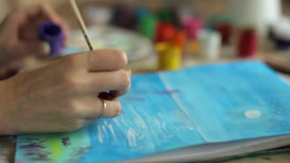 close-up, women's hands artist draws a picture