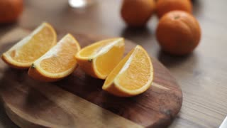 Cuted Slices of Orange on the Board