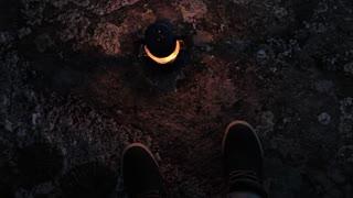 feet and kerosene lamp on the ground
