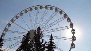Ferris Wheel Against the Sun