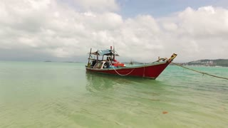 fishing boat on the shore on a clear day
