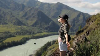 girl at the top of the mountain overlooking the river