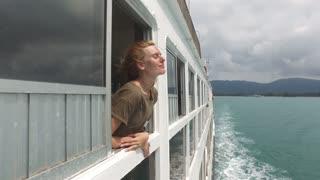 girl enjoys the sea on a big ship