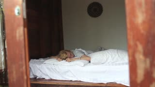 girl is sleeping on the bed in the villa