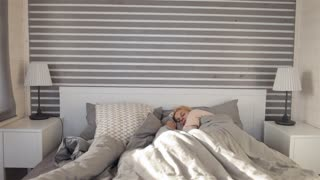 girl wakes up at dawn on the bed