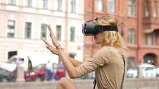 girl with virtual reality glasses on the background of the city