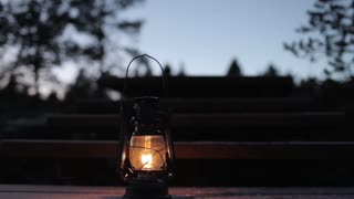 kerosene lamp shines on a wooden staircase in the forest