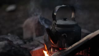 Kettle on the Fire. Camping, Nature.