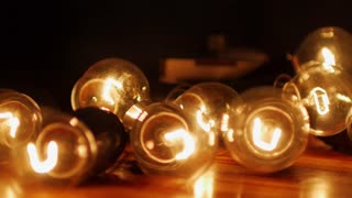man adjusts dimmer the brightness of incandescent lamps