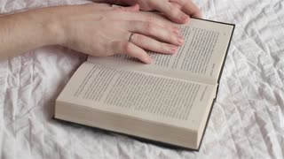 Man Reads a Book, Only His Hands and a Book