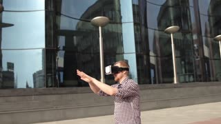 Man Uses a Virtual Reality Glasses at a Glass Modern House