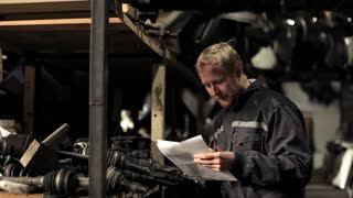 man with the list in stock of used auto parts