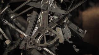 men's hands touch the auto parts