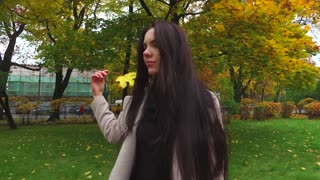 portrait of a girl in an autumn park