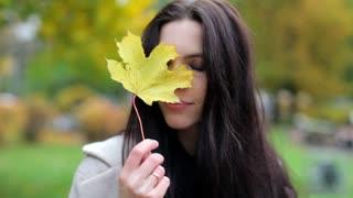 portrait young woman in autumn park