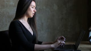 satisfied business woman working with laptop in office