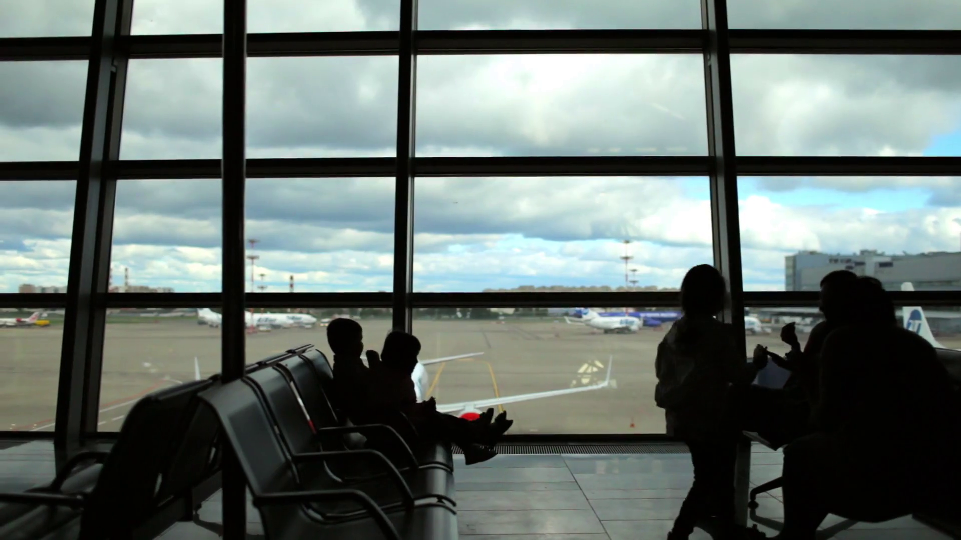 Silhouette Family With Children Sitting In Armchairs In The Airport Departure Zone Stock Video Footage Storyblocks