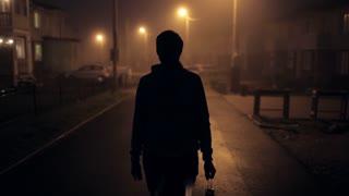 silhouette of a man on a foggy street. man with a kerosene lantern on a foggy street